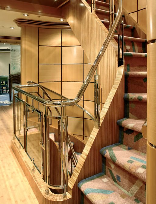 Wooden panelled staircase on Victoria Del Mar