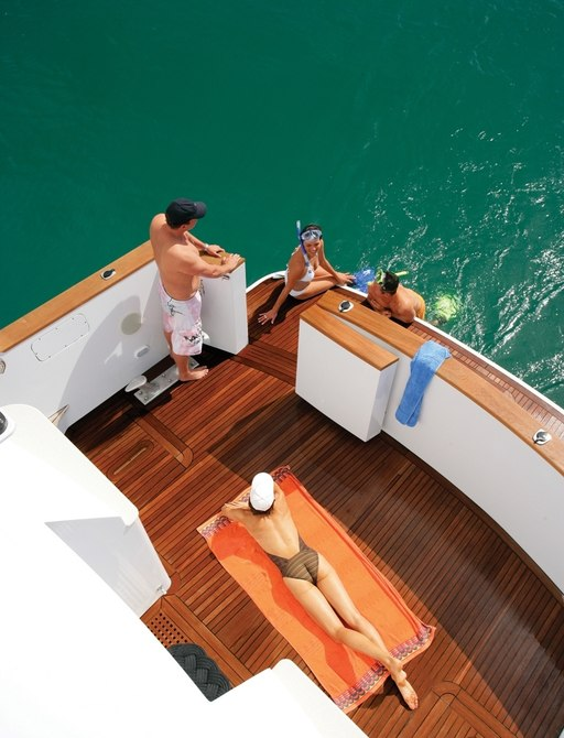 charter guests get close to the Australian waters on the swim platform of charter yacht 'Emerald Lady'