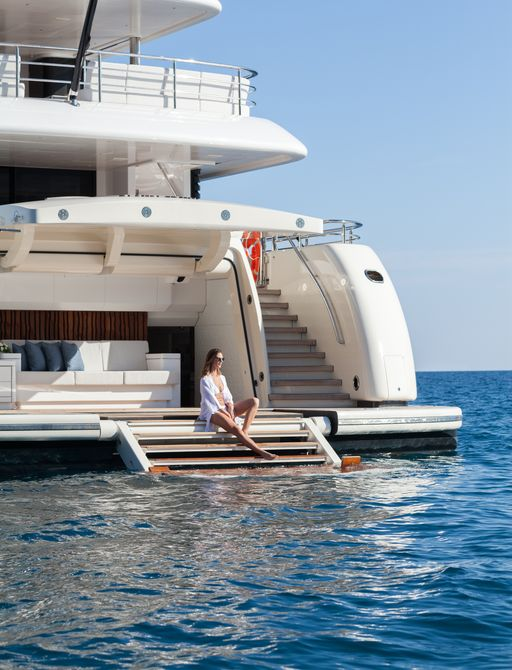 woman on yacht charter doing social distancing