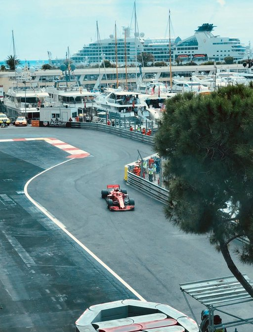 A headlong view of a Formula 1 car practicing on the Monaco Grand Prix track