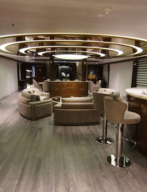 main salon on superyacht baba's with bar and ring lighting