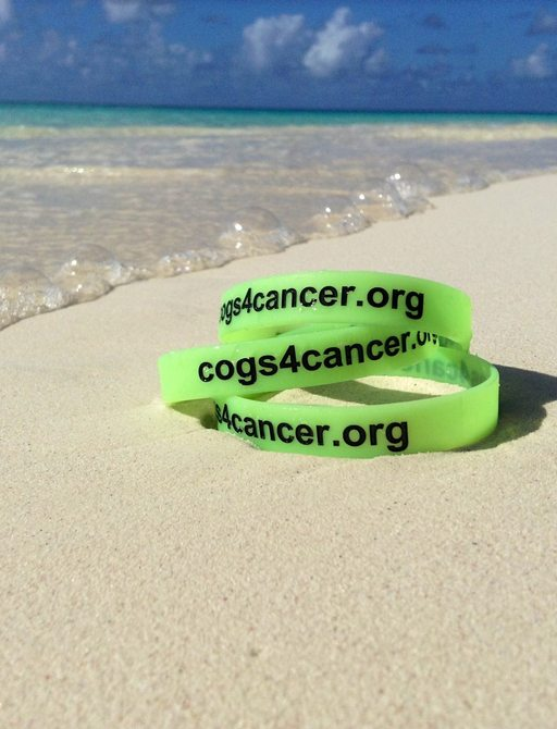 cogs for cancer wristbands on a beach in St Martin island in the caribbean