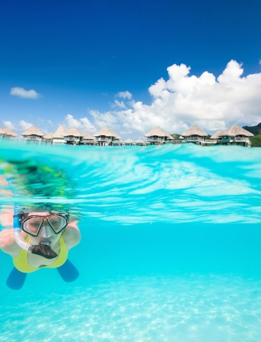 Charter guest snorkelling in the clear waters on the South Pacific