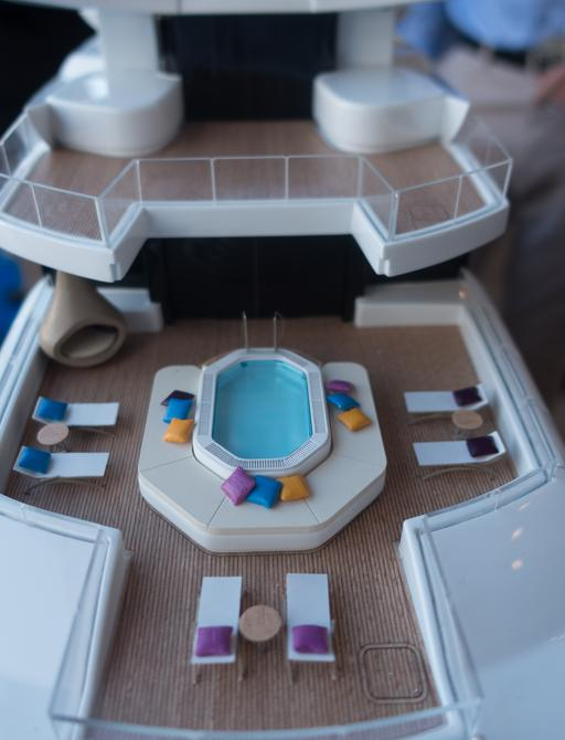 pool, sun pads and loungers on the aft deck of motor yacht Artefact