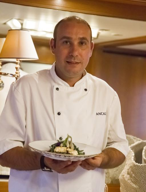 ANCALLIA Chef presenting his dish for the judges