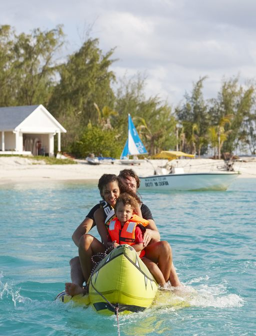 family playing with inflatable bananas on thanda island