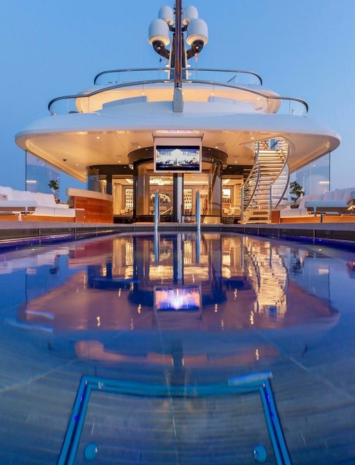 pool on luxury headship yacht hasna, with hanging tv screen in background