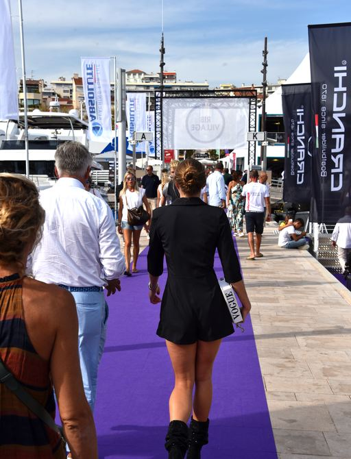 People walking the boardwalks at Cannes yachting festival 2019