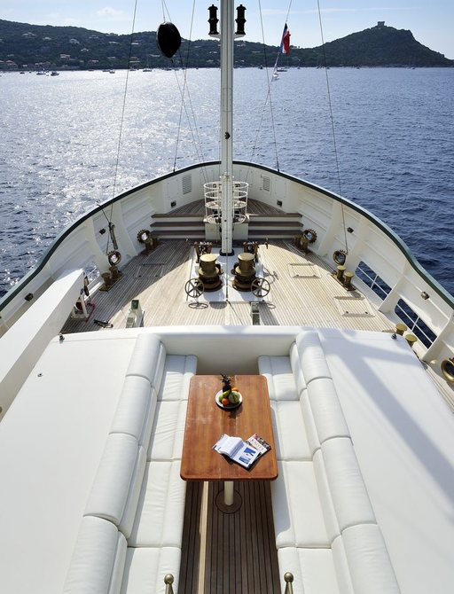 sofas and table on foredeck of expedition yacht STEEL