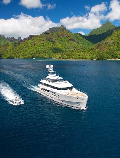 superyacht 'Big Fish' cruising on charter in Fiji alongside tender
