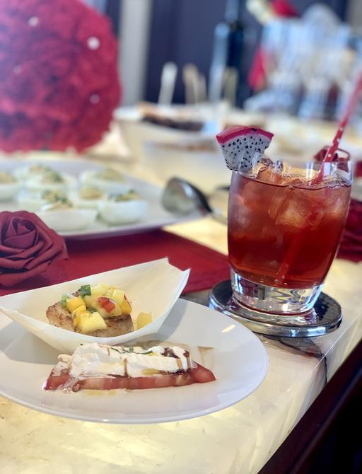 menu tastings at Bahamas charter show, with blackened wahoo and love potion cocktail