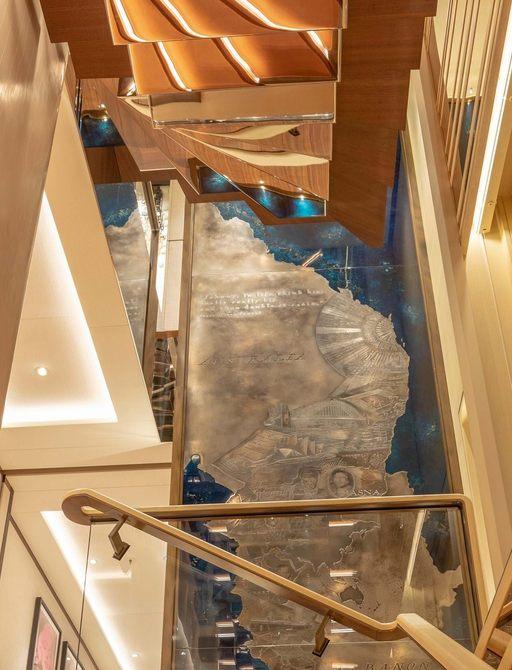luxury yacht lunasea stairwell with blue artworks