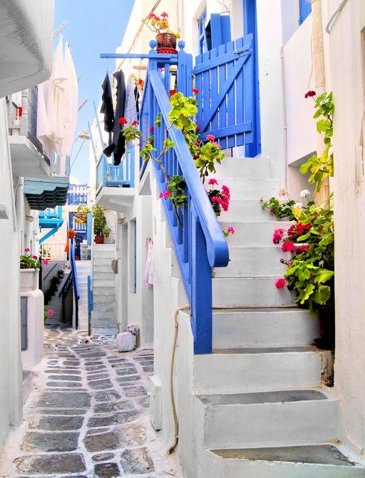 Narrow cobbled alley in Mykonos, Greece