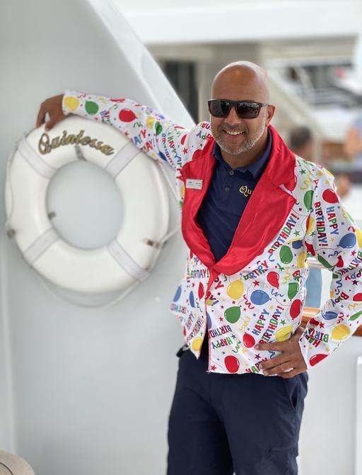 captain of quintessa in birthday costume at bahamas charter show