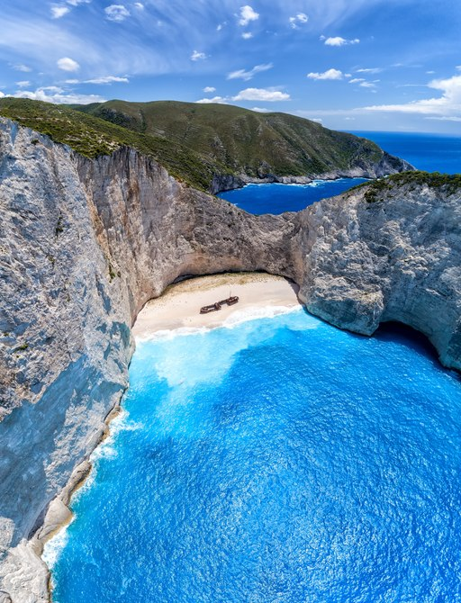 Aerial view of shipwreck cove in Greece, ideal destination for luxury yacht charters