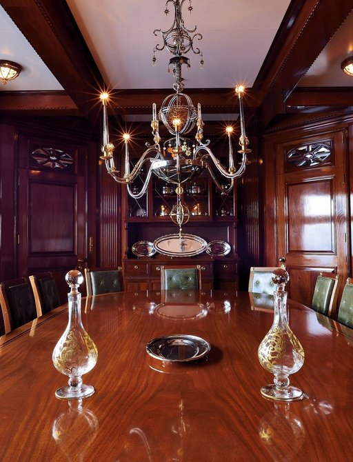 chandelier looks over table in dining room on board charter yacht STEEL