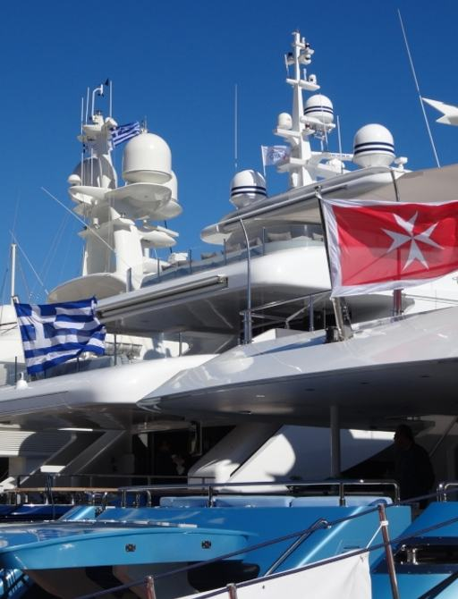Yachts on display with different flags at MEDYS 2014