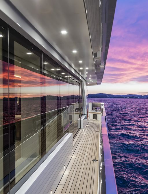 sunset in the distance with exterior decks of superyacht katia in the foreground