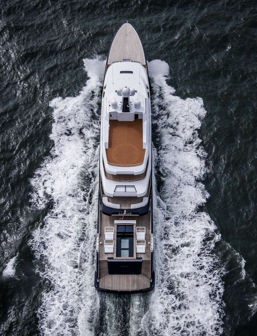 luxury yacht LONIAN underway with view of her aft deck swimming pool