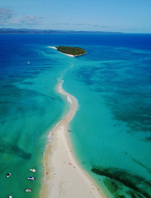 island and low sandbar in the indian ocean