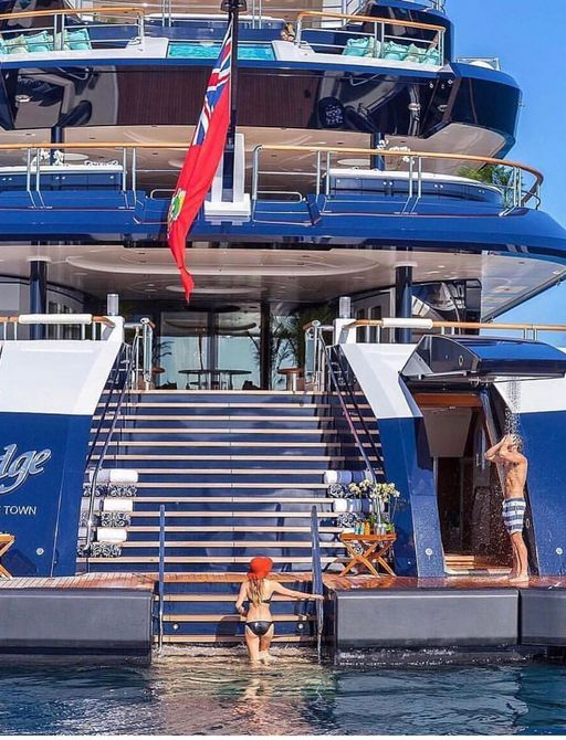 Charter guest boards megayacht from set of steps