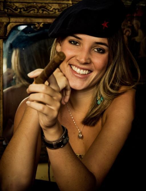 A girl smoking a Cuban cigar