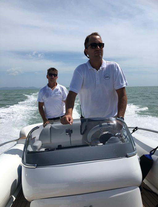 crew members on board motor yacht Talisman Maiton take out the tender at the Thailand Yacht Show & Rendezvous