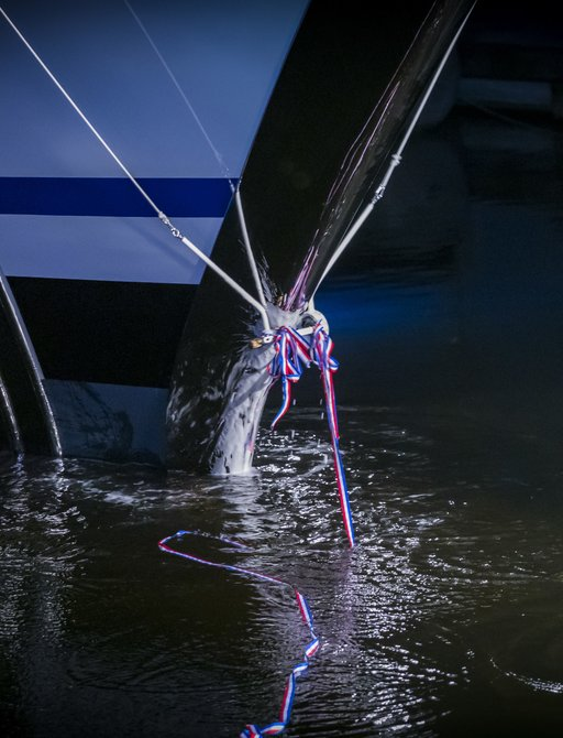 arrow yacht being christened with champagne