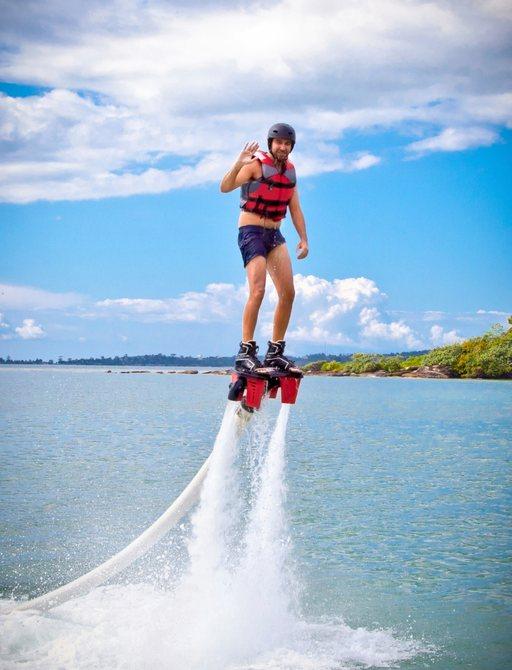 charter guest enjoys water sport