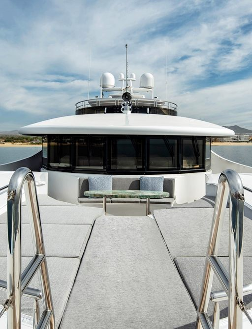 fordeck on luxury motor yacht tsumat, with sofa seating and coffee table