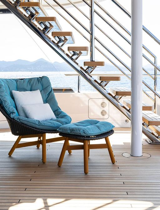 comfortable blue armchair on the deck of charter yacht soaring