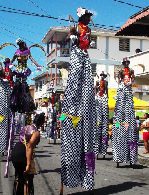 women on Stilts in Costume Parading at Junkanoo carnival