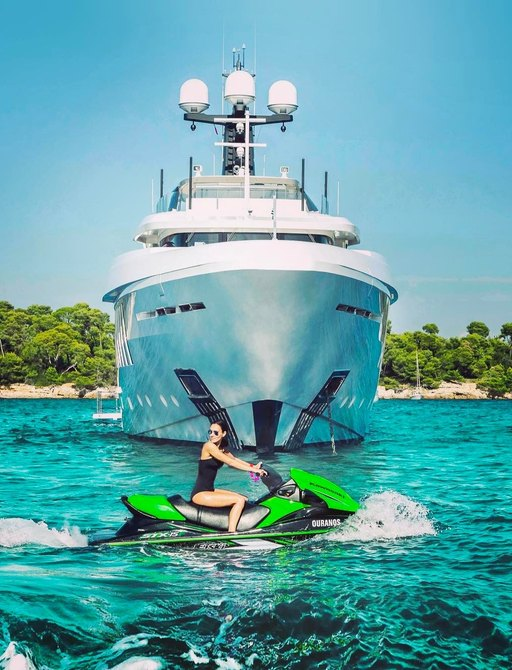 a luxury yacht charter guests enjoying her time on her luxury charter yacht's water toys