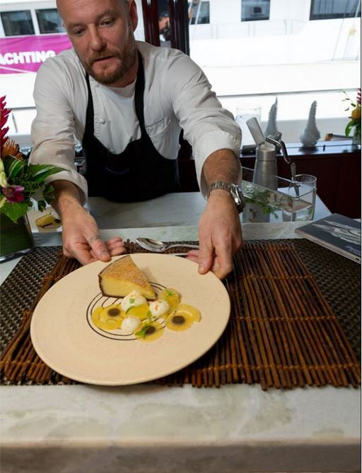 Chef Charlie Blacker serves up tropical fruit dessert aboard superyacht TRENDING at the Antigua Charter Yacht Show