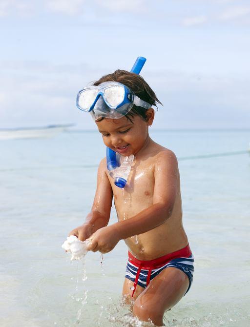 child snorkels in the marine reserve around thanda island