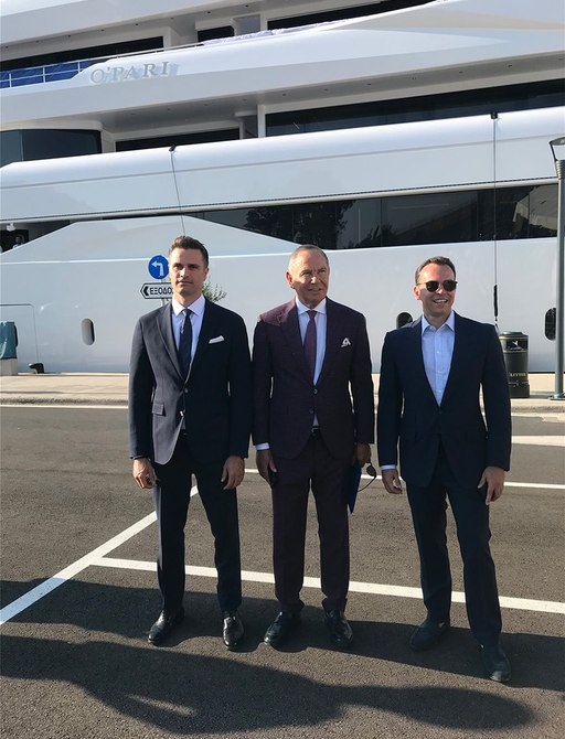 paris dragnis and sons stand in front of o'pari yacht