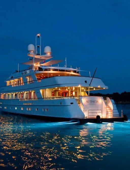 Superyacht AUDACIA lit up at night