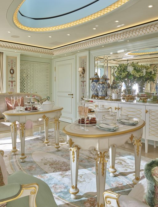 the elegant and classically styled interior of Feadship's TIS presenting a rococo decor palette of creams and pastels in the form of centre tables and chaise lounges