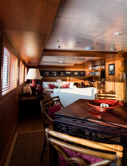 Wooden table and seating on superyacht 'Bleu De Nimes'