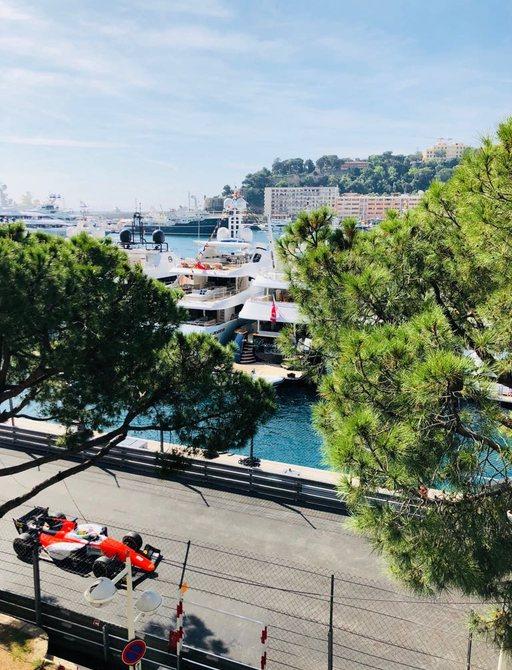 A red Formula 1 racing on the Monaco Grand Prix track