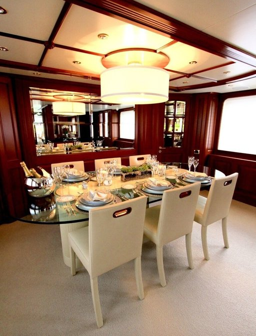 formal dining table in the main salon aboard motor yacht BRUNELLO