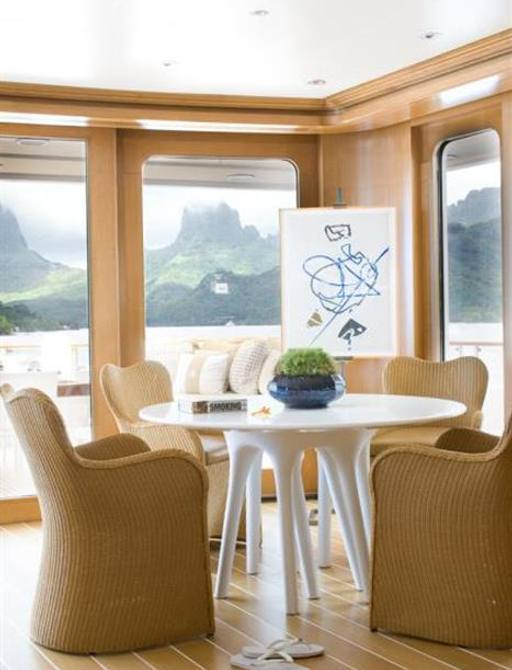 oak-clad salon with small seating area on board luxury yacht Helios