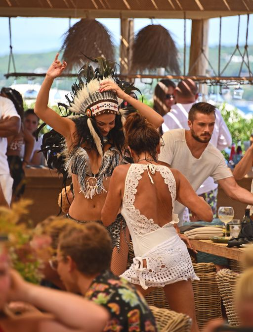 Crowds of people dance at Verde Beach on Pampelonne Bach at St Tropez
