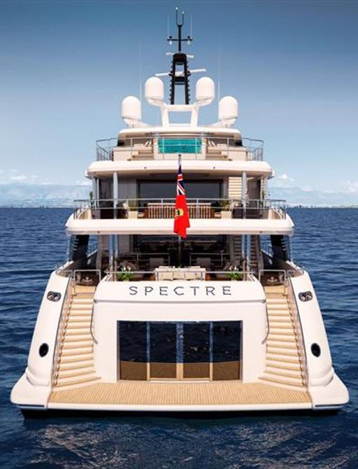 Aft of motor yacht SPECTRE, view of beach club, decks and glass pool on sun deck