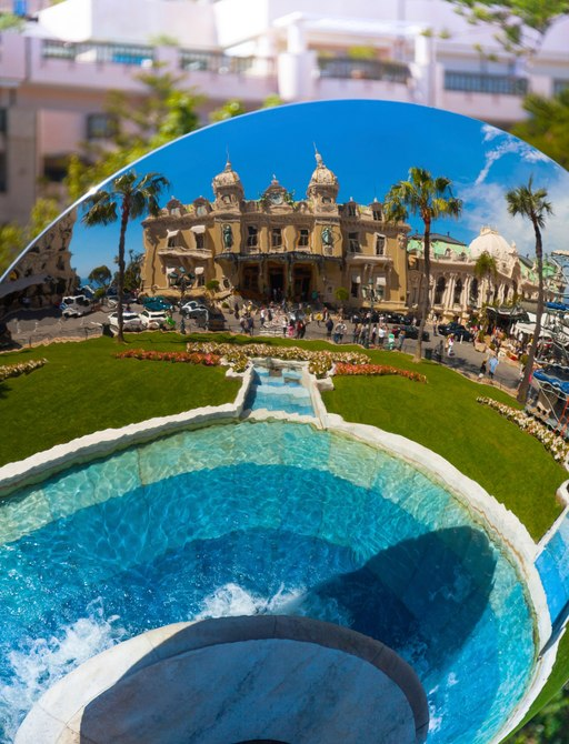 Fountain and grand building reflection in Monaco