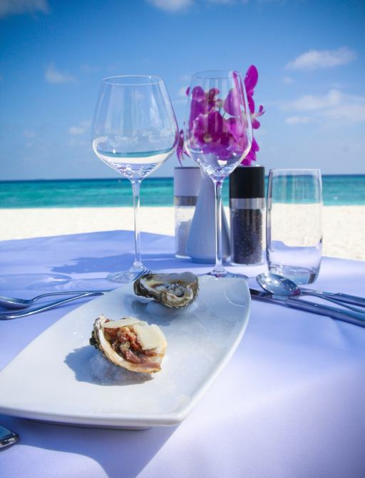 seafood and wine served on tropical beach in the bahams