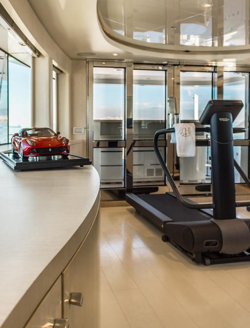 gym area on sundeck of charter yacht light holic with treadmill
