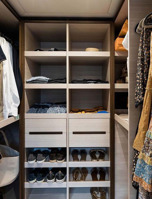 walk in wardrobe in the master cabin of benetti yacht jacozami
