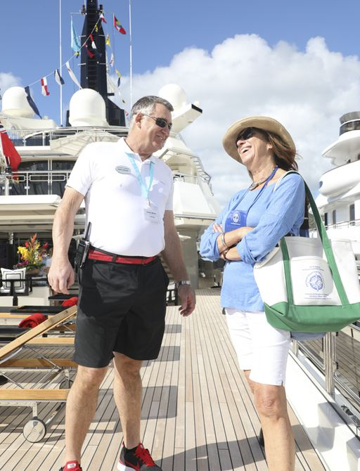broker chats to captain on a yacht at antigua charter show