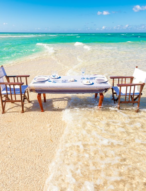 dining on the beach on thanda private island